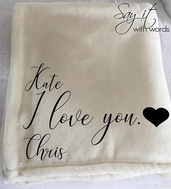 Personalized throw blanket printed with I love you, and their name.