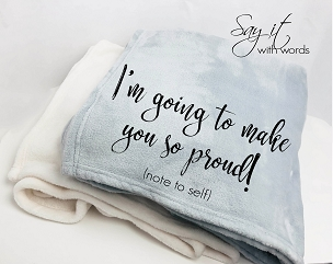 Personalized throw blanket with words about making you so proud, an inspiring gift.