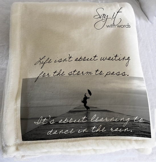 Personalized throw blanket with saying about life isn't about waiting for the storm to pass.  Includes the recipient's name.