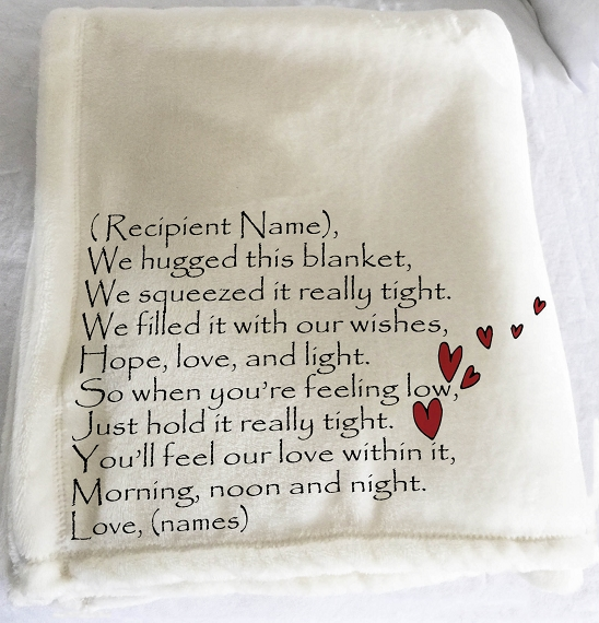 Personalized throw blanket for Christmas.  A message of love on a personalized throw blanket for Grandma with red hearts, we hugged this blanket tight